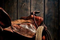 Cowboy occidental américain Western Saddle de rodéo de légende Image libre de droits