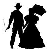 Cowboy och dam Silhouette Arkivbild