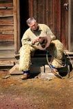 Cowboy op Stoop Royalty-vrije Stock Afbeeldingen