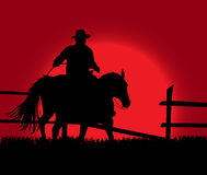 Cowboy over sunset. An illustration of cowboy on the background of the sunset Royalty Free Stock Photography