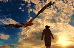 Cowboy på solnedgångbakgrund med en örn - tolkning 3D Royaltyfri Fotografi