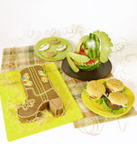 Cowboy party food. Food made for a cowboy party, cake, bull hamburger, watermelon horse and sweet hats Stock Images