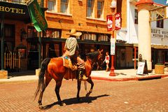 A cowboy is on patrol at the Fort Worth Stockyards, Texas. A cowboy rides his horse as he patrols the Fort Worth Stockyards, Texas stock photography