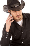 Cowboy on phone eyes closed Stock Photo