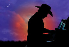 Cowboy Pianist Silhouette Royalty Free Stock Photos