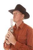 Cowboy pistol blow Royalty Free Stock Photography