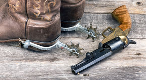 Cowboy pistol and boots. Stock Photo