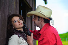 The cowboy with a pistol in hands Stock Photo