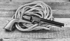 Cowboy Pistol and rope. Royalty Free Stock Photography
