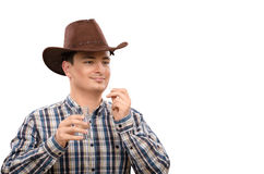 Cowboy in plaid shirt taking pill Royalty Free Stock Photos