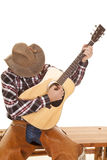 Cowboy play guitar head down Royalty Free Stock Images