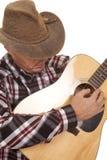 Cowboy play guitar very close Stock Image