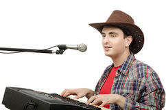 Cowboy playing digital piano Royalty Free Stock Photos
