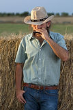 Cowboy Playing Harmonica royalty free stock photography