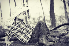 Cowboy Playing on Tree Trunk Stock Images