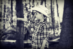 Cowboy Pointing. A young five year old boy dressed like a cowboy playing in the forest and pointing at something he sees royalty free stock photos