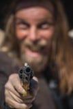 Cowboy Points Gun an Ihnen Stockbild