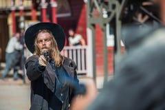 Cowboy Points Gun Stock Images