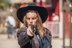Cowboy Points Gun på dig Royaltyfri Fotografi
