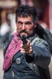 Cowboy Points Gun Stock Photo