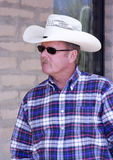 Cowboy portrait. Portrait of a cowboy wearing hat and sunglasses royalty free stock photos