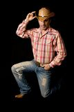 Cowboy posing 2. Adult cow boy looking great and posing for fashion shots royalty free stock image