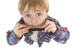 Cowboy Preschooler plays harmonica Royalty Free Stock Images
