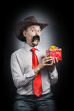 Cowboy with present Stock Photo
