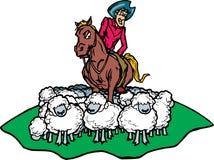Cowboy que agrupa carneiros Fotos de Stock Royalty Free