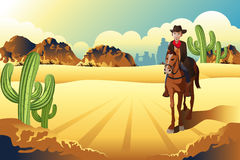 Cowboy que monta um cavalo Imagem de Stock