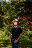 Cowboy Rancher in front of Pine Tree stock image