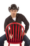 Cowboy red chair serious Stock Photography