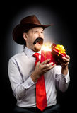 Cowboy with red present Royalty Free Stock Photo