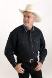 Cowboy regardant outre de l'appareil-photo Images libres de droits