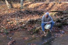 Cowboy resting By the Stream Stock Image