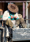 Cowboy resting at the Western Town Stock Photography