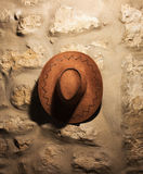 Cowboy retro brown hat on the wall Royalty Free Stock Images