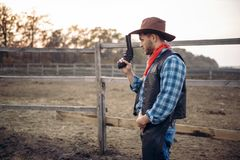 Cowboy with revolver, gunfight in gesert valley royalty free stock photos