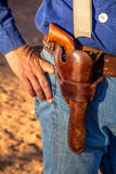 Cowboy with Revolver in Holster Royalty Free Stock Photography