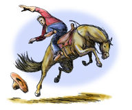Cowboy riding a bucking bronco Royalty Free Stock Photography