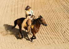 Cowboy riding at full gallop Royalty Free Stock Photos