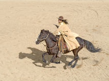 Cowboy riding at full gallop Royalty Free Stock Photography