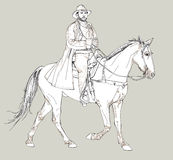 Cowboy riding a horse Stock Images