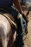 A cowboy riding a horse. A close up view of a cowboy riding his horse with his rope Stock Images