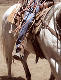 A cowboy riding a horse. A close up view of a cowboy riding his horse with tack and ready to rope Royalty Free Stock Image