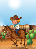 Cowboy. Riding horse in the desert Stock Image