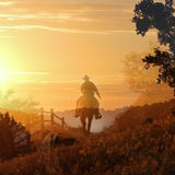 Cowboy riding on a horse I. A cowboy riding a horse on a mountain trail into the sunset stock photography