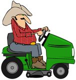 Cowboy on a riding lawnmower Royalty Free Stock Image