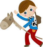CowBoy riding a stick, puppet horse. Young boy playing with a puppet horse Stock Image