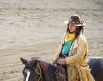 Cowboy riding into town royalty free stock photos